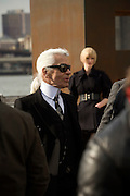 Karl Lagerfeld with model and crew during a shoot on Fulton Landing, Brooklyn, NY. March 24, 2008