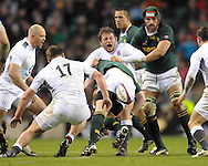 © SPORTZPICS /SECONDS LEFT IMAGES 2010 - Rugby Union - Investec  Internationals  - England v South Africa - 27/11/10 - England's  Steve Thompson receives a crunching tackle from Bismarck du Plessis minutes from time - at Twickenham Stadium UK -  All rights reserved