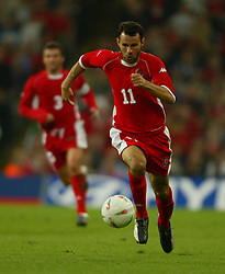 CARDIFF, WALES - Wednesday, September 10, 2003: Wales' Ryan Giggs in action against Finland during the Euro 2004 qualifying match at the Millennium Stadium.. (Photo by David Rawcliffe/Propaganda)