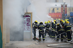 Firemen work to put out fire in a shopping mall in Harbin, capital of northeast China's Heilongjiang Province, Jan. 7, 2012. Casualty information is unknown yet after the fire started at around 9 a.m. (0100 GMT) in the Guorun Home Textiles Shopping Mall in downtown Harbin on Monday. The fire consumed an area of 9,400 square meters over the course of three and a half hours before being stopped. Firefighters helped evacuate shoppers from the five-story building, China, January 7, 2013. Photo by Imago / i-Images...UK ONLY