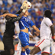 Goalkeeper Jan Jan Williams, Trinidad and Tobago, saves while challenged by Mark Blanco, El Salvador, during the El Salvador Vs Trinidad and Tobago CONCACAF Gold Cup group B football match at Red Bull Arena, Harrison, New Jersey. USA. 8th July 2013. Photo Tim Clayton