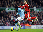 Emmanuel Adebayor (Manchester City) & Emiliano Insua  (Liverpool) during the Barclays Premier League match between Liverpool and Manchester City at Anfield - 21/11/09