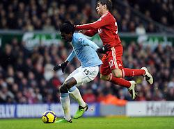 Emmanuel Adebayor (Manchester City) & Emiliano Insua  (Liverpool) during the Barclays Premier League match between Liverpool and Manchester City at Anfield - 21/11/09