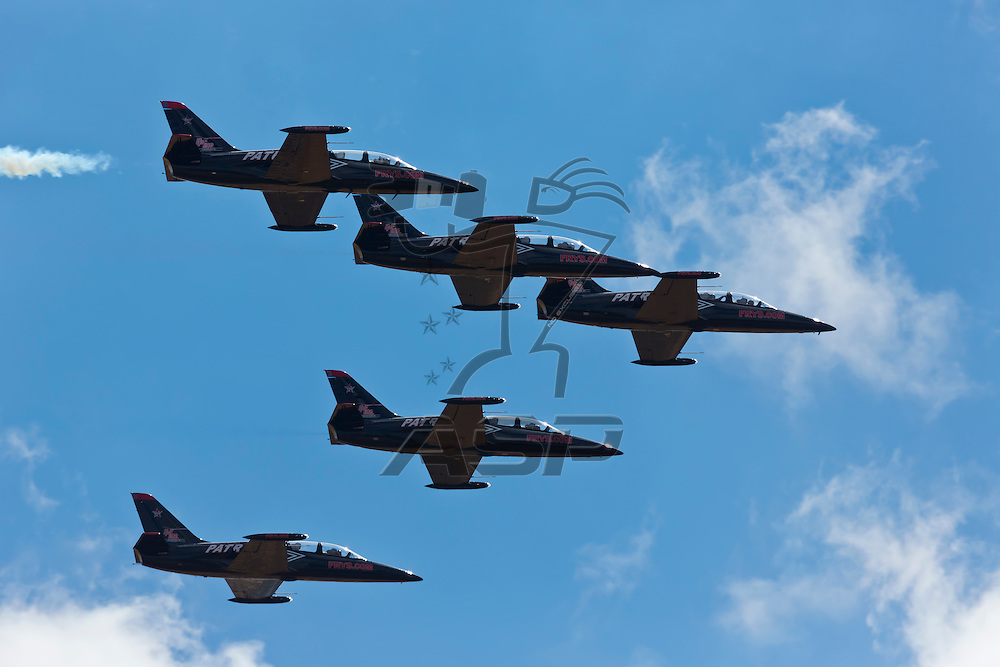 SONOMA, CA - JUN 24, 2012:  The nation's only civilian aerobatic jet team, The Patriots Jet Team, perform before the Toyota Save Mart 350 at the Raceway at Sonoma in Sonoma, CA.