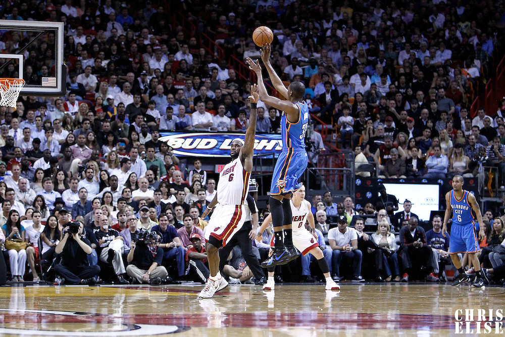 16 March 2011: Oklahoma City Thunder small forward Kevin Durant (35) takes a jumpshot Miami Heat small forward LeBron James (6) during the Oklahoma City Thunder 96-85 victory over the Miami Heat at the AmericanAirlines Arena, Miami, Florida, USA.