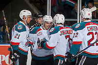 KELOWNA, CANADA - JANUARY 18: Devante Stephens #21, Nick Merkley #10, Lucas Johansen #7 and Braydyn Chizen #22 of the Kelowna Rockets celebrate a second period goal against the Moose Jaw Warriors on January 18, 2017 at Prospera Place in Kelowna, British Columbia, Canada.  (Photo by Marissa Baecker/Shoot the Breeze)  *** Local Caption ***