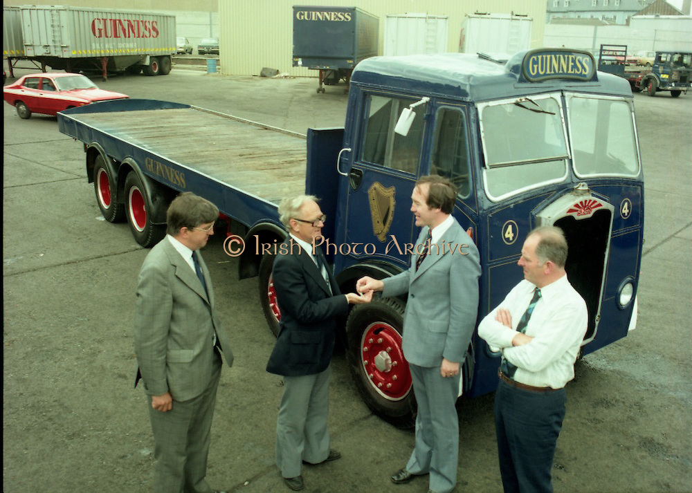 """Handover of Old Guinness Truck.   (M83)..1979..24.07.1979..07.24.1979..24th July 1979..The Albion Truck registration number RLV 154 was officially handed over to the Howth, National Transport Museum today. The vehicle was found in a scrap yard and purchased by the museum. History checking on the vehicle found that it had been part of the Guinness fleet both in Ireland and England. On hearing about the truck Guinness came on board and helped restore the vehicle to its former glory. An  eight wheeler of model type HD57 it is classed as a very rare model. The truck is powered by a six cylinder 'Whispering Giant' engine..Albion were a commercial vehicle builder based in Scotland..To see this and many other rare vehicles The museum is located in the Heritage Depot, Howth Demesne, Howth, Ireland. 60 vehicles are currently in Howth on display. .Image shows the official handover of the """"Albion"""" by Guinness to the National Transport Museum."""