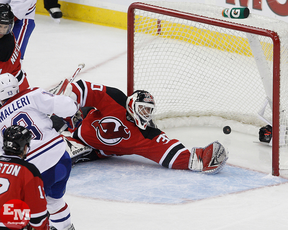 Jan 22, 2010; Newark, NJ, USA; Montreal Canadiens left wing Mike Cammalleri (13) scores a goal past New Jersey Devils goalie Martin Brodeur (30) during the third period at the Prudential Center. The Canadians defeated the Devils 3-1.