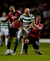 Photo: Jed Wee.<br /> Glasgow Celtic v FC Copenhagen. UEFA Champions League, Group F. 26/09/2006.<br /> <br /> Celtic's Thomas Gravesen (C) is crowded out by Copenhagen's Hjalte Norregaard (L) and Tobias Linderoth.