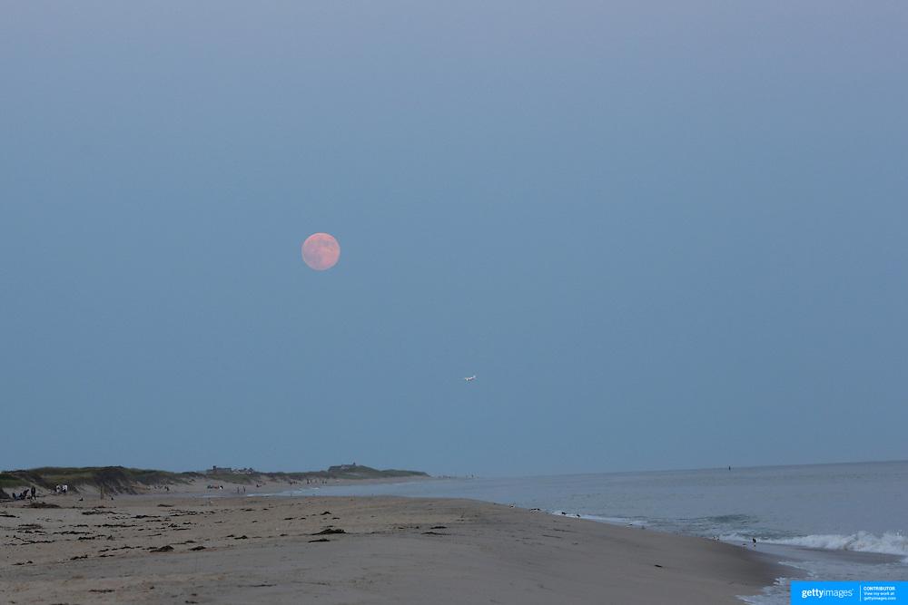 The moon rises at dusk in the height of summer on Cisco Beach, Nantucket, Nantucket Island, Massachusetts, USA. Photo Tim Clayton