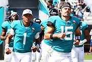 Oct 13, 2019; Jacksonville, FL USA;  Jacksonville Jaguars quarterback Joshua Dobbs (1) and Jaguars quarterback Gardner Minshew (15) come out of the tunnel before an NFL game against the New Orleans Saints at TIAA Bank Field in Jacksonville, FL. The Saints beat the Jaguars 13-6. (Steve Jacobson/Image of Sport)
