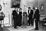 President John F. Kennedy entertained at a dinner party given by President Éamon de Valera at Áras an Uachtaráin. Included in the group are An Taoiseach Seán Lemass, Sinéad Bean de Valera and Mrs Eunice Shriver.