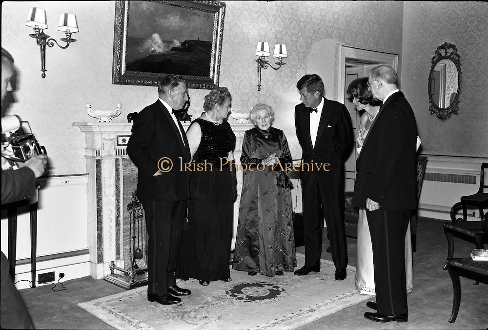 President John F. Kennedy entertained at a dinner party given by President Éamon de Valera at Áras an Uachtaráin. Included in the group are An Taoiseach Seán Lemass, Sinéad Bean de Valera and Mrs Eunice Shriver.