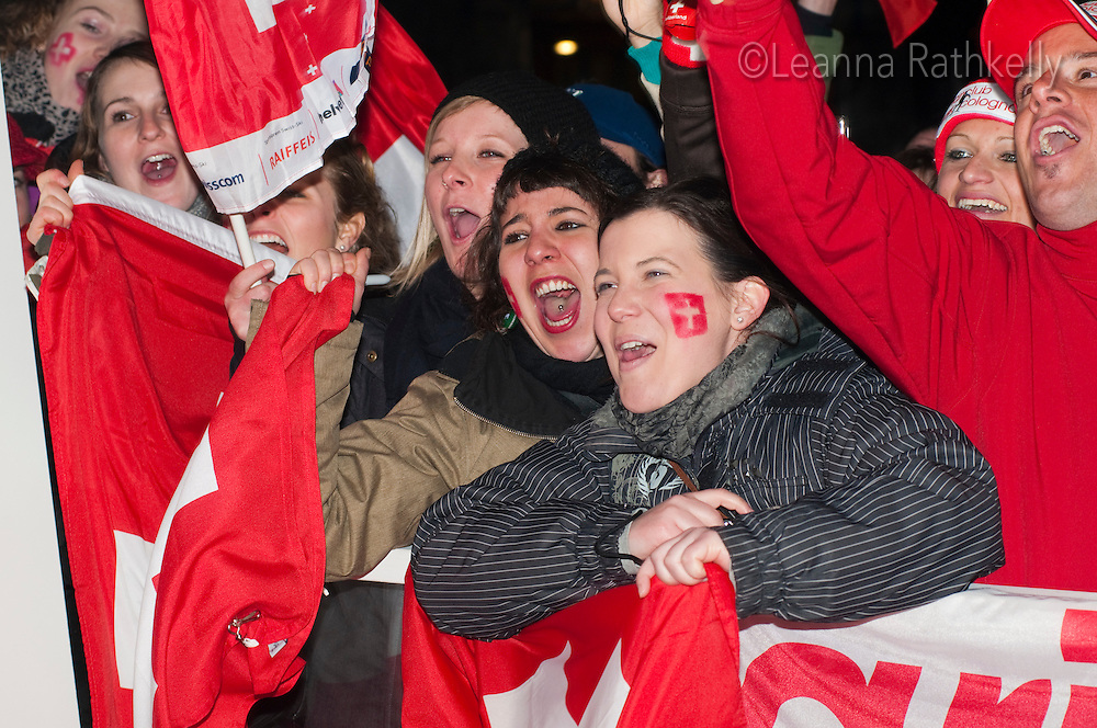 A crowd of people cheer for the Gold Medal winners Dario Cologna and Didier Defago at the House of Switzerland in Whistler during the 2010 Olympic Winter games in Whistler, BC Canada.
