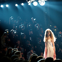 A model pauses in front the hordes of photographers during an exhibit of the Charles Anastase autumn 2011 collection at the Old Sorting Office in London on 19 February 2011.