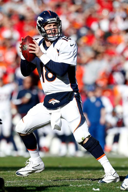 KANSAS CITY, MO - NOVEMBER 25:  Peyton Manning #18 of the Denver Broncos drops back to pass against the Kansas City Chiefs at Arrownhead Stadium on November 25, 2012 in Kansas City, Missouri.  (Photo by Wesley Hitt/Getty Images) *** Local Caption *** Peyton Manning
