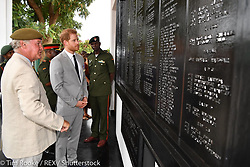 """Kensington Palace releases a photo on Twitter with the following caption: """"""""📖The Duke of Sussex views the service record book of Thom Butts — who served between 1941 and 1945. #RoyalVisitZambia"""""""". Photo Credit: Twitter *** No USA Distribution *** For Editorial Use Only *** Not to be Published in Books or Photo Books ***  Please note: Fees charged by the agency are for the agency's services only, and do not, nor are they intended to, convey to the user any ownership of Copyright or License in the material. The agency does not claim any ownership including but not limited to Copyright or License in the attached material. By publishing this material you expressly agree to indemnify and to hold the agency and its directors, shareholders and employees harmless from any loss, claims, damages, demands, expenses (including legal fees), or any causes of action or allegation against the agency arising out of or connected in any way with publication of the material."""