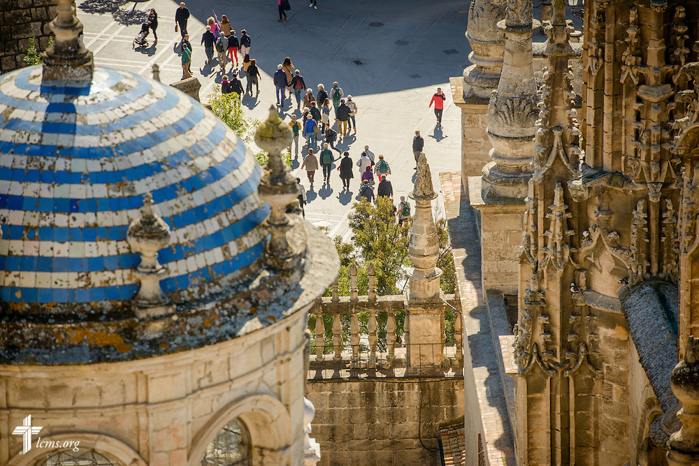 Tourists stroll around the Seville Cathedral on Monday, Nov. 7, 2016, in Seville, Spain.  LCMS Communications/Erik M. Lunsford
