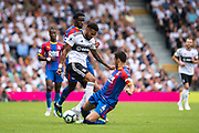 Fulham (22) Cyrus Christie, Luka Milivojević (4) of Crystal Palace, Jeffrey Schlupp (15) of Crystal Palace during the Premier League match between Fulham and Crystal Palace at Craven Cottage, London, England on 11 August 2018.