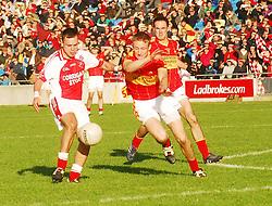 Castlebar Mitchels captain Alan Feeney gets a block in on Ballintubber's Alan Plunkett during the County senior football final...Pic Conor McKeown