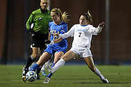 30 November 2013: UCLA's Samantha Mewis (22) and North Carolina's Kealia Ohai (7). The University of North Carolina Tar Heels played the University of California Los Angeles Bruins at Fetzer Field in Chapel Hill, North Carolina in a 2013 NCAA Division I Women's Soccer Tournament Quarterfinal match. UCLA won the game 1-0 in two overtimes.