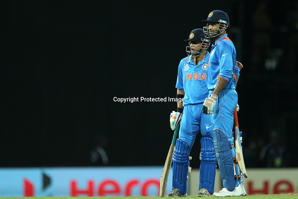 Gautam Gambhir and Irfan Pathan wait for the decision on Gautam Gambhir's wicket during the ICC World Twenty20 Super 8s match between Australia and India held at the Premadasa Stadium in Colombo, Sri Lanka on the 28th September 2012<br /> <br /> Photo by Ron Gaunt/SPORTZPICS
