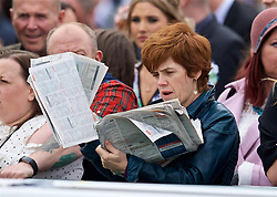 LIVERPOOL, ENGLAND - Thursday, April 6, 2017: A racegoers reads the form, during The Opening Day on Day One of the Aintree Grand National Festival 2017 at Aintree Racecourse. (Pic by David Rawcliffe/Propaganda)