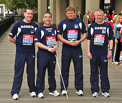 © under license to London News Pictures. 15/04/2010 Police team including Pc David Rathband (tango 196) who was shot and blinded by Raoul Moat attends photocall ahead of this Sundays 2011 London Virgin Marathon by Tower Bridge London. Photo credit should read ALAN ROXBOROUGH /LNP