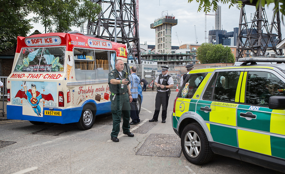 © Licensed to London News Pictures. 30/06/2015. London, UK. An ice cream van arrives on the scenne of a simulated terrorist attack called 'Exercise Strong Tower' between the three emergency services, which continued today with an exercise at Wood Wharf.  Photo credit : James Gourley/LNP