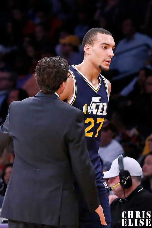 19 March 2015: Utah Jazz center Rudy Gobert (27) goes back to the game passing by Utah Jazz head coach Quin Snyder during the Utah Jazz 80-73 victory over the Los Angeles Lakers, at the Staples Center, Los Angeles, California, USA.
