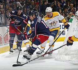 November 7, 2017 - Columbus, OH, USA - The Columbus Blue Jackets' Brandon Dubinsky (17) collects the puck against the Nashville Predators' Frederick Gaudreau (89) during the first period at Nationwide Arena on November 7, 2017. (Credit Image: © Kyle Robertson/TNS via ZUMA Wire)
