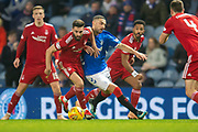 Graeme Shinnie (#3) of Aberdeen FC holds off Eros Grezda (#35) of Rangers FC during the Ladbrokes Scottish Premiership match between Rangers and Aberdeen at Ibrox, Glasgow, Scotland on 5 December 2018.