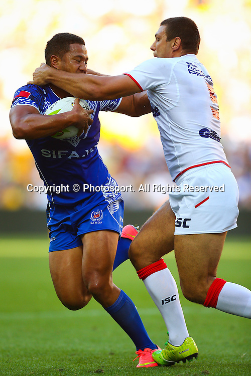 Kyle Stanley (L) is tackled by Ryan Hallduring (R) the Four Nations test match between England and Samoa at Suncorp Stadium,  Brisbane Australia on October 18, 2014.