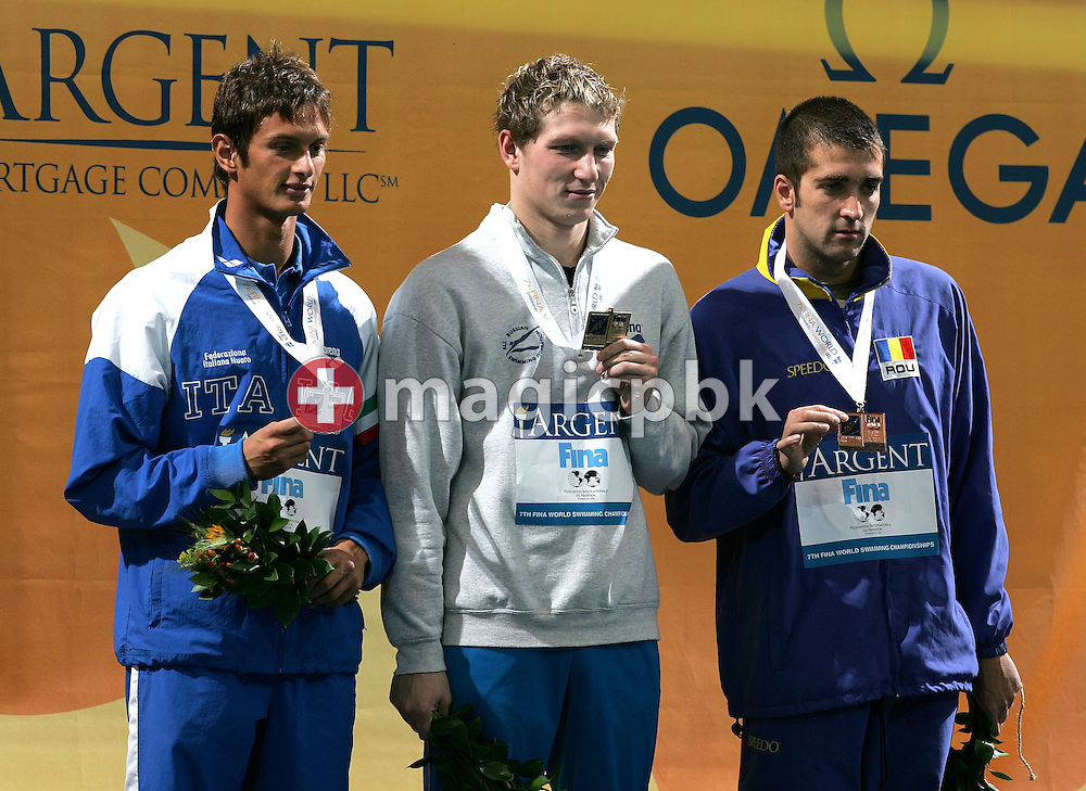The podium (L to R) of the men's 1500 m freestyle with..Simone Ercoli (Silver) of Italy, Yuri Prilukov of Russia (Gold) and Dragos Coman (Bronze) of Romania at the Swimming Short Course World Championships at Conseco Fieldhouse in Indianapolis, Indiana, Monday 11 October 2004. (Photo by Patrick B. Kraemer / MAGICPBK)