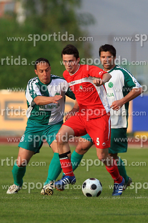 Marko Sotensek of Zagorje between Ales Ceh and Amir Karic of Olimpija at football match of 2nd SNL between NK Olimpija Ljubljana and NK Zagorje, on May 03, 2009, in ZAK stadium, Ljubljana, Slovenia. Olimpija won 9:0 and 4 Rounds before the end won the 1st place in 2nd SNL. Next year they will play in First Slovenian League. (Photo by Vid Ponikvar / Sportida)
