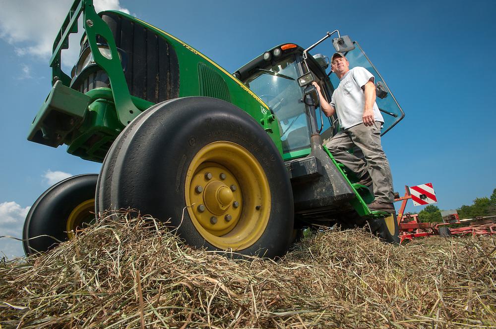 Farmer tedding hay in Sudlersville, Maryland, USA