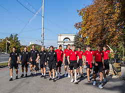 CHISINAU, MOLDOVA - Thursday, October 10, 2019: (L-R) Wales' U21 physio Dyfri Owen, masseur Dave Rowe, goalkeeping coach Alec Chamberlain , sport scientist Peter Sharp, kit man Paul Carter, Ben Cabango, goalkeeper Adam Przybek, Harry Clifton, Jack Vale, Robbie Burton, and Keiran Evans during a team walk in Chisinau ahead of the UEFA Under-21 Championship Italy 2019 Qualifying Group 9 match between Moldova and Wales. (Pic by Kunjan Malde/Propaganda)
