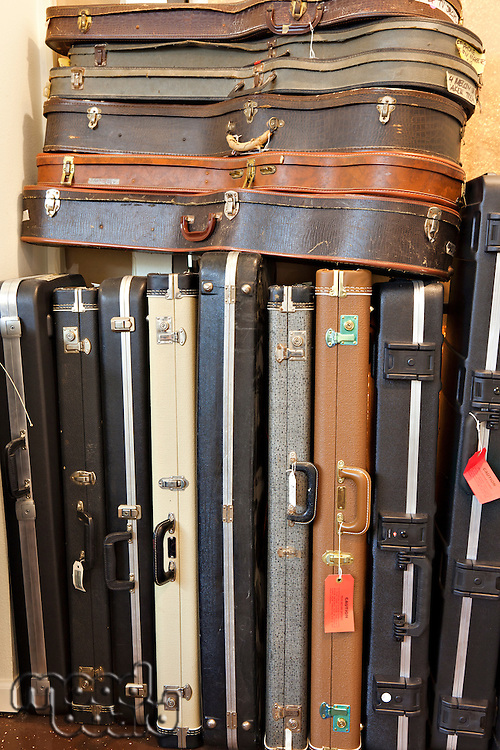 Group of old guitar case in music store