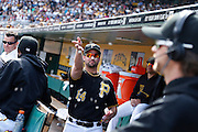 Gaby Sanchez #14 of the Pittsburgh Pirates tosses sunflower seeds toward pitcher A.J. Burnett while he does an interview during the game against the Washington Nationals on May 4, 2013 at PNC Park in Pittsburgh, Pennsylvania. (Photo by Joe Robbins)