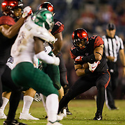 22 September 2018: San Diego State Aztecs running back Chase Jasmin (22) rushes the ball for a short gain in overtime. The San Diego State Aztecs beat the Eastern Michigan Eagles 23-20 in over time at SDCCU Stadium in San Diego, California.