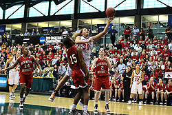 20 March 2010: Slipping past Jaimie McFarlin, Carrie Snikkers lets go of a lay up. The Flying Dutch of Hope College fall to the Bears of Washington University 65-59 in the Championship Game of the Division 3 Women's NCAA Basketball Championship the at the Shirk Center at Illinois Wesleyan in Bloomington Illinois.