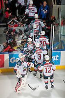 KELOWNA, CANADA - MARCH 8: The Kelowna Rockets exit the ice and celebrate the 7-0 win against the Tri City Americans on March 8, 2014 at Prospera Place in Kelowna, British Columbia, Canada. With the win, the Rockets set a new franchise record of 54 season wins.  (Photo by Marissa Baecker/Getty Images)  *** Local Caption ***