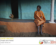 Very happy to be 1 of the 2 Australian photographers to have won the prestigious Loupe Award in 2011 with this image, The woman and the chicken. http://www.australiangeographic.com.au/journal/view-image.htm?index=3&gid=10697<br /> Winner 3d place at International Loupe Awards 2012.<br /> Exclusive at Getty Images.<br /> http://www.gettyimages.com.au/Search/Search.aspx?contractUrl=2&language=en-US&assetType=image&p=ingetje+tadros