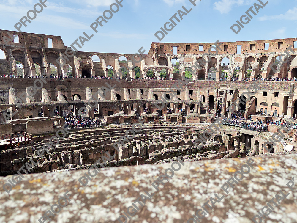 Inside view of the Colosseum with tourists during the day