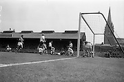 24/05/1964<br /> 05/24/1964<br /> 24 May 1964<br /> Soccer International: Ireland v England at Dalymount Park, Dublin. England won the game 3-1.  Melee in the Irish goalmouth after a corner kick, resulting in a goal from English inside forward Jimmy Greaves.Players in the image from left are Bobby Charlton (11 England); Johnny Byrne (9 England); Mick McGrath (Ireland,on ground); goalie Noel Dwyer and Jimmy Greaves (England).