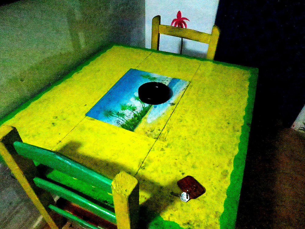 cottage patio dining table at night: Casas del Mar Neptunia, Las Terrenas, Semana Peninsula.