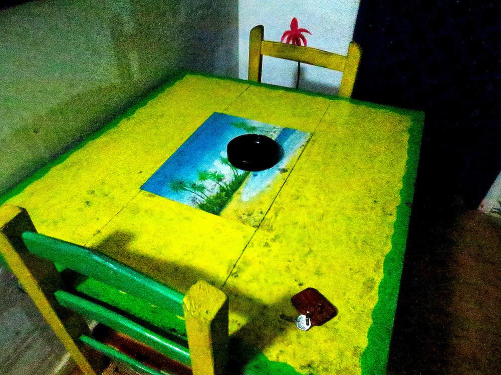 cottage patio dining table at night: Casas del Mar Neptunia, Las Terrenas, Semana Peninsula.