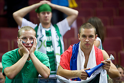 Dissapointed Slovenian fans after the EuroBasket 2009 Semi-final match between Slovenia and Serbia, on September 19, 2009, in Arena Spodek, Katowice, Poland. Serbia won after overtime 96:92.  (Photo by Vid Ponikvar / Sportida)