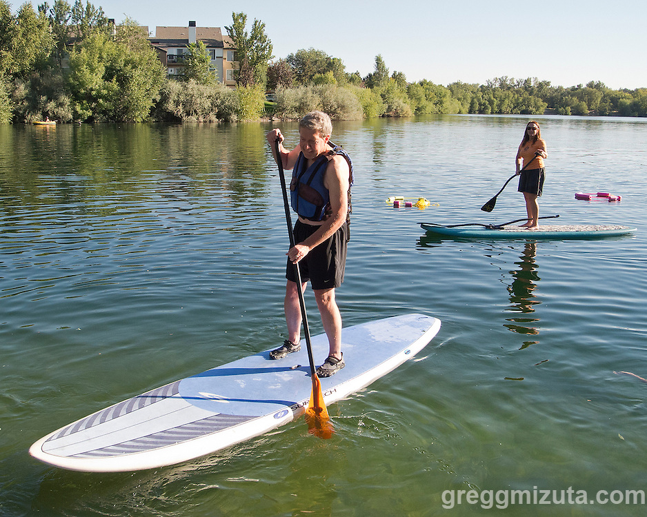 Brian Rencher and Jo Cassin at Western Capital Bank's first annual SUP & SIP event at Quinn's Pond and Idaho River Sports in Boise, Idaho on September 5, 2012.