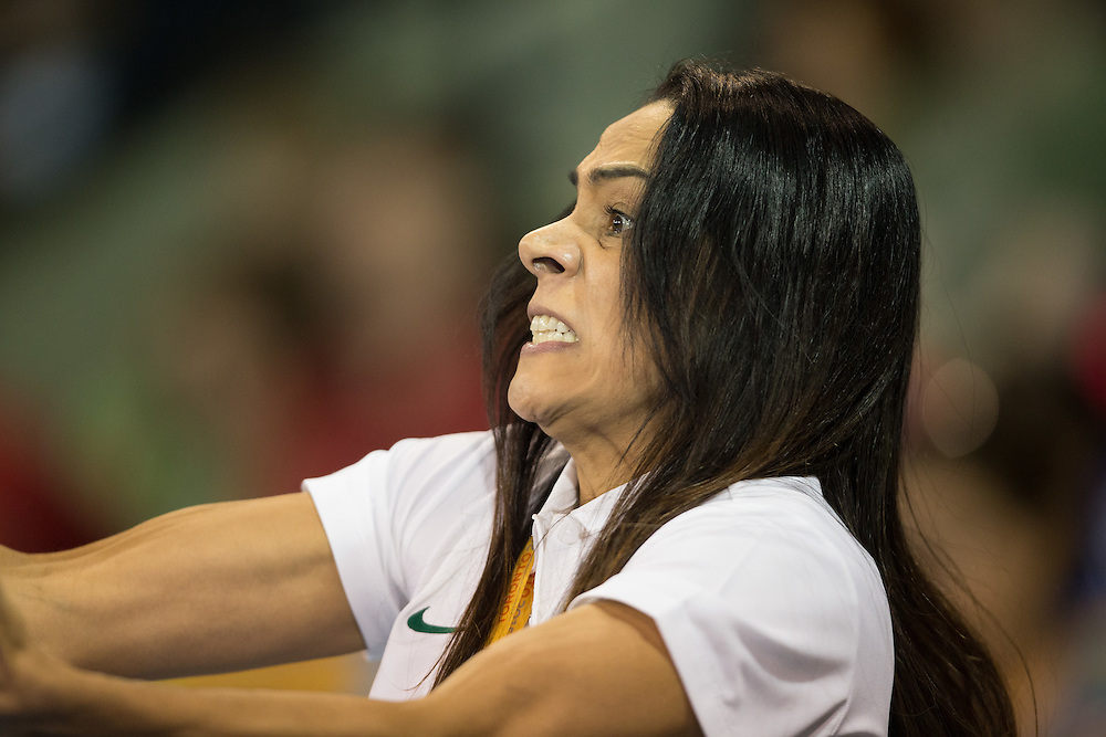 Brazilian judo coach Rosicleia Campos reacts as her athlete Maria Portela competes in the women's -70kg final of the table against Canadian Kelita Zupancic at the 2015 Pan American Games in Toronto, Canada, July 13,  2015.  Portal lost to Zupancic and will compete against Andrea Poo of Mexico for the bronze medal Monday evening. AFP PHOTO/GEOFF ROBINS